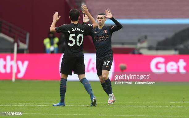 Manchester City's Phil Foden celebrates scoring his side's first goal with Eric Garcia during the Premier League match between West Ham United and...