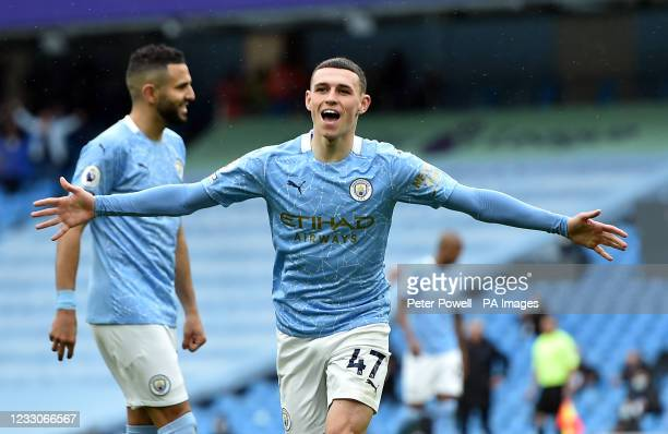 Manchester City's Phil Foden celebrates scoring their side's third goal of the game during the Premier League match at the Etihad Stadium,...