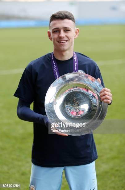 Manchester City's Phil Foden celebrates winning the U18 Northern Premier League trophy