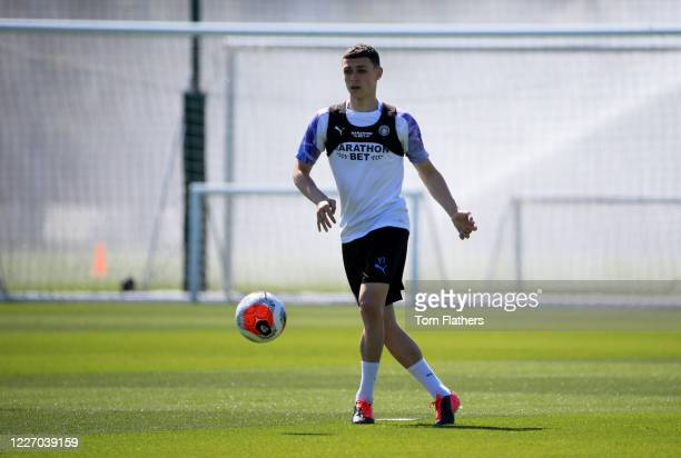 Manchester City's Phil Foden in action during training at Manchester City Football Academy on May 25 2020 in Manchester England