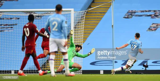 Manchester City's Phil Foden Scores Citys third Goal during the Premier League match between Manchester City and Liverpool FC at Etihad Stadium on...