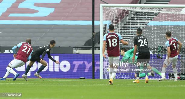Manchester City's Phil Foden scores his side's first goal during the Premier League match between West Ham United and Manchester City at London...