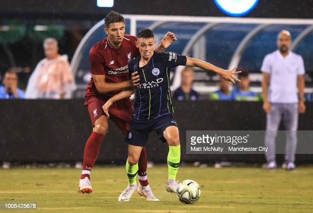 Manchester City's Phil Foden takes on Liverpool's Marko Grujic during the International Champions Cup match between Manchester City and Liverpool at...