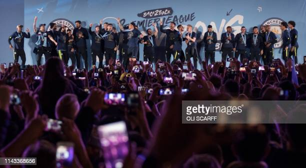 Manchester City's players and coaching staff get ready to present the Premier League trophy to supporters outside the Etihad Stadium in Manchester...
