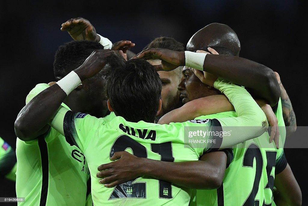 Manchester City's players celebrate after scoring a goal during the UEFA Champions League quarter final football match between Paris Saint Germain (PSG) and Manchester City on April 6, 2016 at the Parc des Princes stadium in Paris.