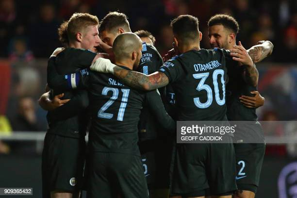 Manchester City's players celebrate after scoring their second goal during the English League Cup semifinal second leg football match between Bristol...