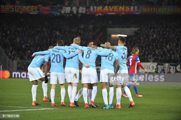 Manchester City's players celebrate after their fourth goal during the UEFA Champions League round of 16 first leg football match between Basel and...