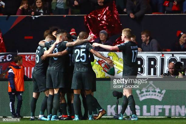 Manchester City's players celebrate their opening goal during the English League Cup semifinal second leg football match between Bristol City and...