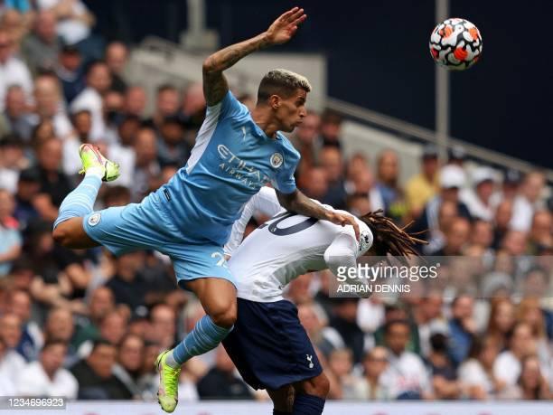 Manchester City's Portuguese defender Joao Cancelo vies with Tottenham Hotspur's English midfielder Dele Alli during the English Premier League...