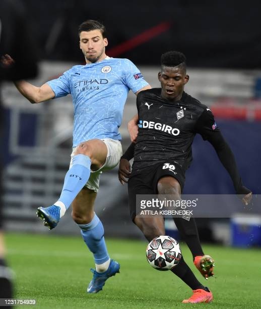 Manchester City's Portuguese defender Ruben Dias vies with Borussia Moenchengladbach's Swiss forward Breel Embolo during the UEFA Champions League,...