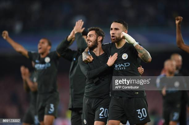 Manchester City's Portuguese midfielder Bernardo Silva and Manchester City's Argentinian defender Nicolas Otamendi celebrate at the end of the UEFA...
