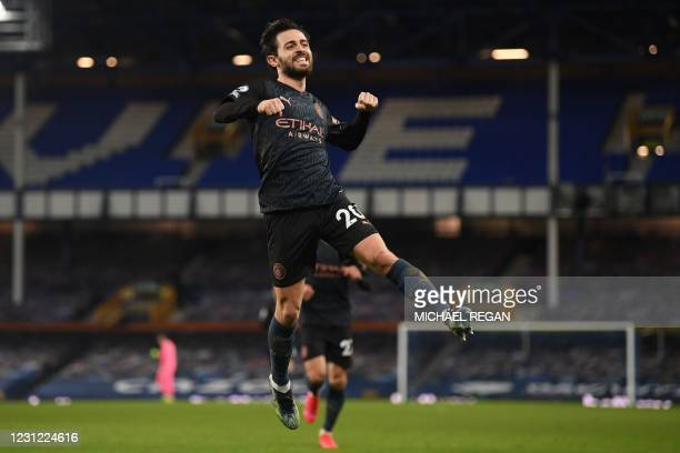 Manchester City's Portuguese midfielder Bernardo Silva celebrates scoring his team's third goal during the English Premier League football match...