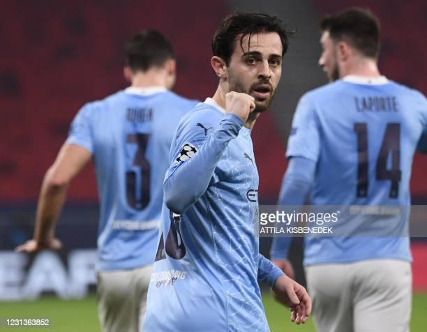 Manchester City's Portuguese midfielder Bernardo Silva celebrates scoring his team's first goal during the UEFA Champions League, last 16, 1st-leg...