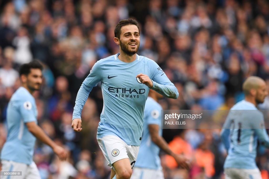 Manchester City's Portuguese midfielder Bernardo Silva celebrates scoring his team's fourth goal during the English Premier League football match between Manchester City and Swansea at the Etihad Stadium in Manchester, north west England, on April 22, 2018. (Photo by Paul ELLIS / AFP) / RESTRICTED TO EDITORIAL USE. No use with unauthorized audio, video, data, fixture lists, club/league logos or 'live' services. Online in-match use limited to 75 images, no video emulation. No use in betting, games or single club/league/player publications. /