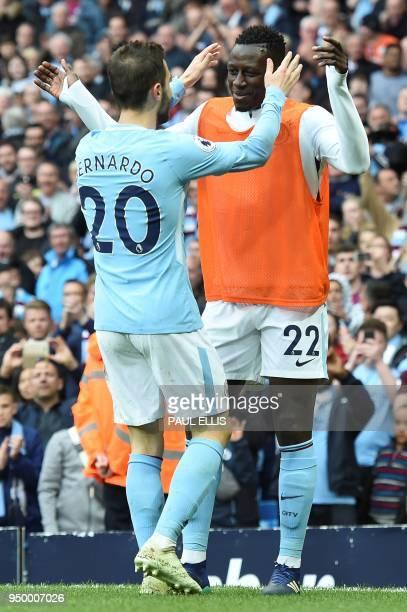 Manchester City's Portuguese midfielder Bernardo Silva celebrates scoring his team's fourth goal with Manchester City's French defender Benjamin...