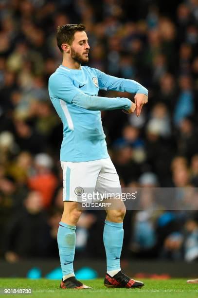 Manchester City's Portuguese midfielder Bernardo Silva celebrates scoring their fourth goal during the English FA Cup third round football match...