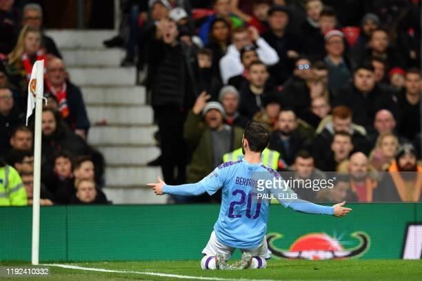 Manchester City's Portuguese midfielder Bernardo Silva celebrates scoring the opening goal during the English League Cup semifinal first leg football...