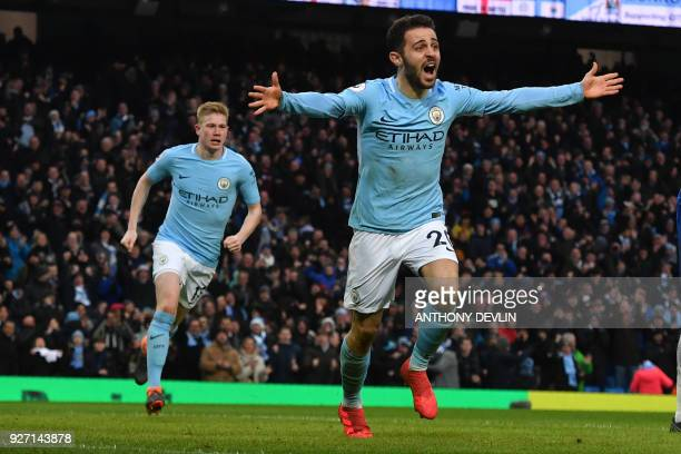 Manchester City's Portuguese midfielder Bernardo Silva celebrates scoring the opening goal during the English Premier League football match between...