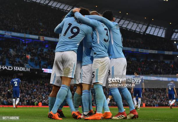 Manchester City's Portuguese midfielder Bernardo Silva celebrates scoring the opening goal with teammates during the English Premier League football...