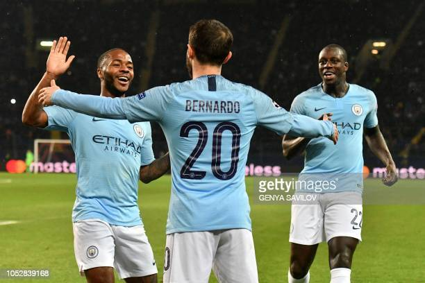 Manchester City's Portuguese midfielder Bernardo Silva celebrates with teammates after scoring a goal during the UEFA Champions League football match...