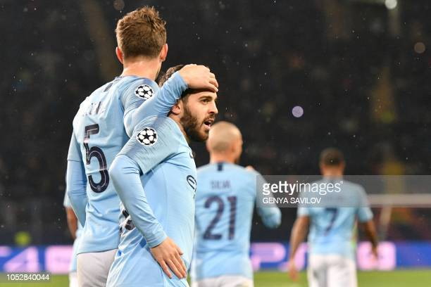 Manchester City's Portuguese midfielder Bernardo Silva celebrates with teammate after scoring a goal during the UEFA Champions League football match...