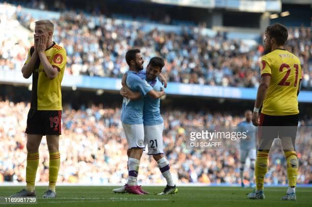 Manchester City's Portuguese midfielder Bernardo Silva celebrates with Manchester City's Spanish midfielder David Silva after he scores the team's...