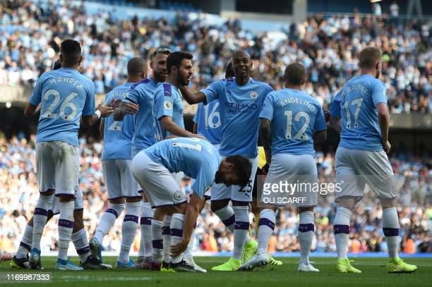 Manchester City's Portuguese midfielder Bernardo Silva celebrates with teammates after he scores the team's sixth goal during the English Premier...