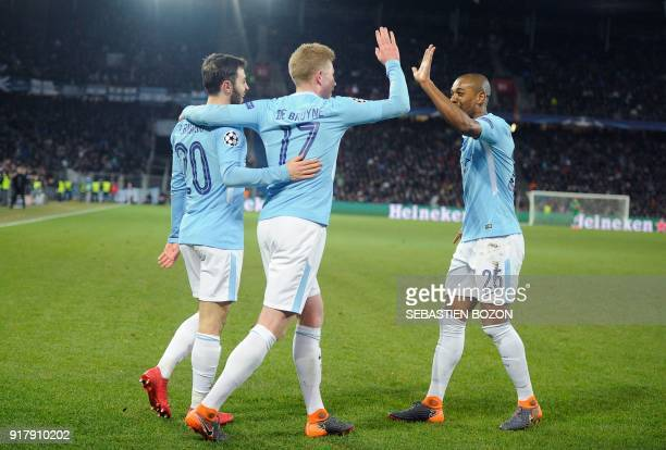 Manchester City's Portuguese midfielder Bernardo Silva celebrates with Manchester City's Brazilian midfielder Fernandinho and Manchester City's...
