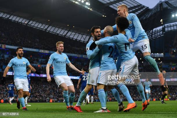 TOPSHOT Manchester City's Portuguese midfielder Bernardo Silva celebrates with tammates scoring the opening goal during the English Premier League...