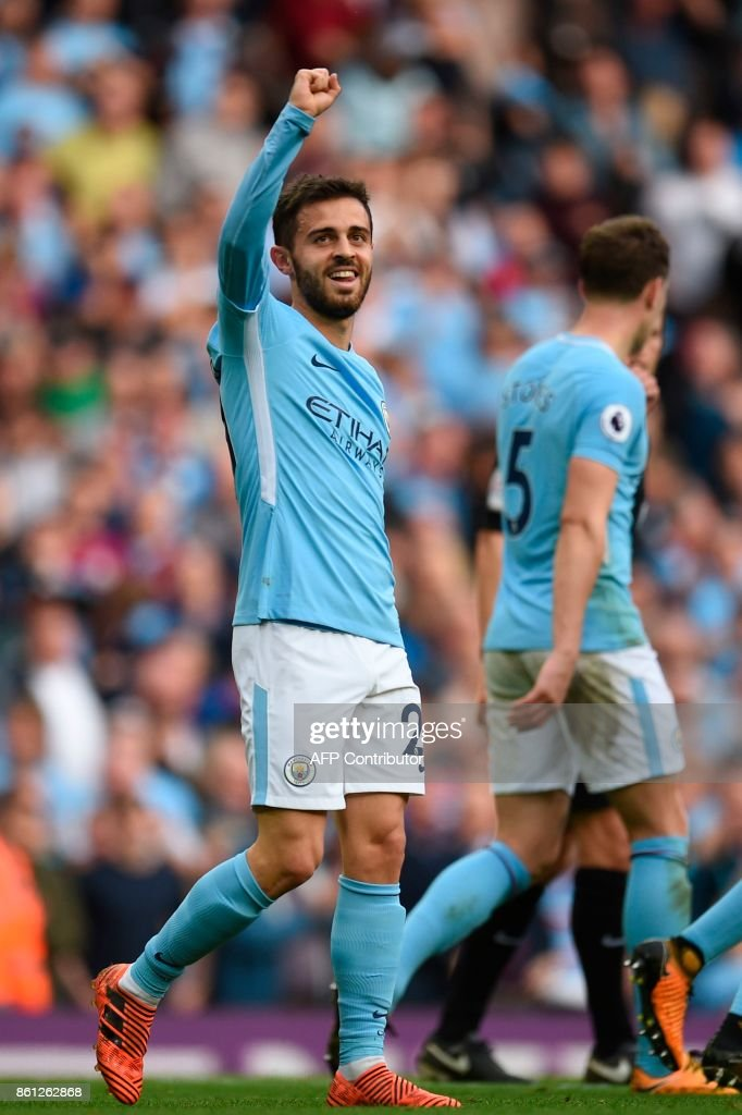 Manchester City's Portuguese midfielder Bernardo Silva celerbates scoring their seventh goal during the English Premier League football match between Manchester City and Stoke City at the Etihad Stadium in Manchester, north west England, on October 14, 2017. / AFP PHOTO / Oli SCARFF / RESTRICTED TO EDITORIAL USE. No use with unauthorized audio, video, data, fixture lists, club/league logos or 'live' services. Online in-match use limited to 75 images, no video emulation. No use in betting, games or single club/league/player publications. /