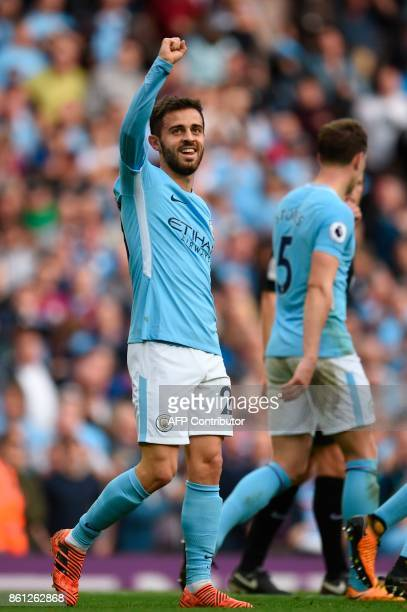 Manchester City's Portuguese midfielder Bernardo Silva celerbates scoring their seventh goal during the English Premier League football match between...