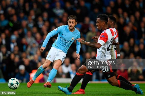 Manchester City's Portuguese midfielder Bernardo Silva has a shot which is saved during the UEFA Champions League Group F football match between...