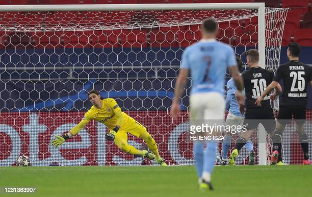 Manchester City's Portuguese midfielder Bernardo Silva scores the opening goal past Moenchengladbach's Swiss goalkeeper Yann Sommer during the UEFA...