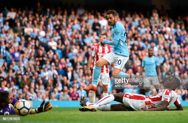Manchester City's Portuguese midfielder Bernardo Silva scores their seventh goal during the English Premier League football match between Manchester...