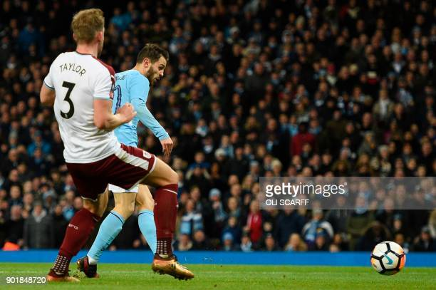 Manchester City's Portuguese midfielder Bernardo Silva scores their fourth goal during the English FA Cup third round football match between...