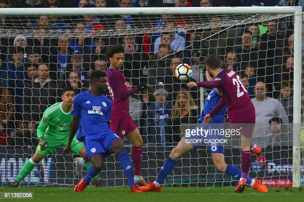 Manchester City's Portuguese midfielder Bernardo Silva scores with this shot but it is later disallowed for an off-side against Manchester City's...