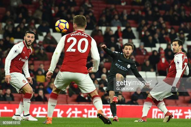 Manchester City's Portuguese midfielder Bernardo Silva shoots to score the opening goal of the English Premier League football match between Arsenal...