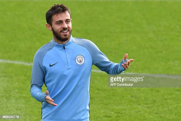 Manchester City's Portuguese midfielder Bernardo Silva takes part in a team training session at the City Football Academy in Manchester north west...