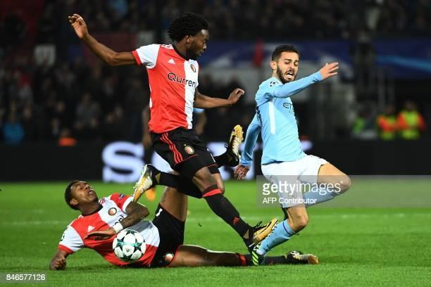 Manchester City's Portuguese midfielder Bernardo Silva vies for the ball with Feyenoord's Dutch defender Miquel Nelom and Feyenoord's Dutch striker...