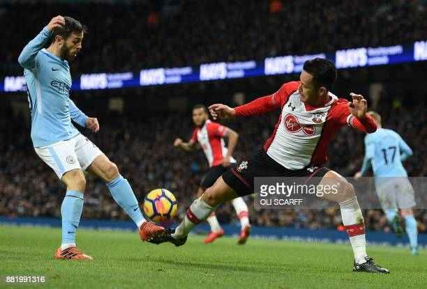 Manchester City's Portuguese midfielder Bernardo Silva vies with Southampton's Japanese defender Maya Yoshida during the English Premier League...