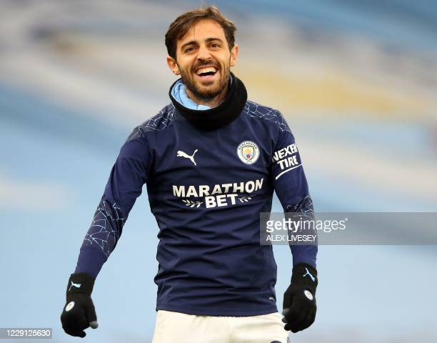 Manchester City's Portuguese midfielder Bernardo Silva warms up for the English Premier League football match between Manchester City and Arsenal at...