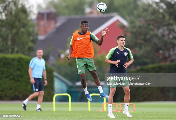 Manchester City's Rabbi Matondo and Phil Foden during training at Manchester City Football Academy on July 16 2018 in Manchester England