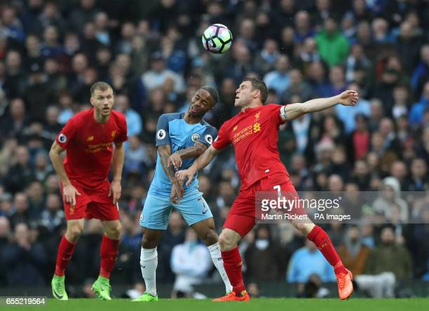 Manchester City's Raheem Sterling and Liverpool's James Milner battle for the ball during the Premier League match at the Etihad Stadium Manchester