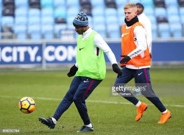Manchester City's Raheem Sterling and Oleksandr Zinchenko during training at Manchester City Football Academy on March 2 2018 in Manchester England