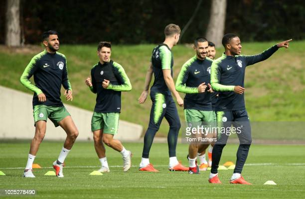 Manchester City's Raheem Sterling and teammates during training at Manchester City Football Academy on August 30 2018 in Manchester England