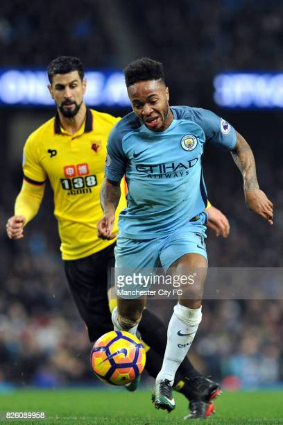 Manchester City's Raheem Sterling and Watford's Miguel Angel Britos in action during the Premiership match at the Etihad Stadium Manchester on 14th...
