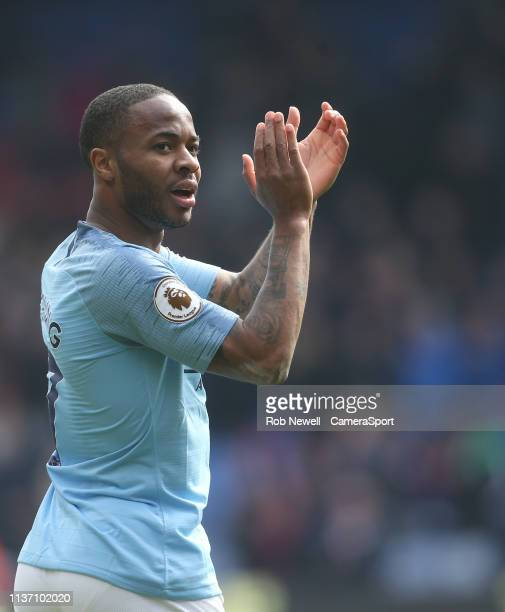 Manchester City's Raheem Sterling applauds the Manchester City fans at the end of the game during the Premier League match between Crystal Palace and...