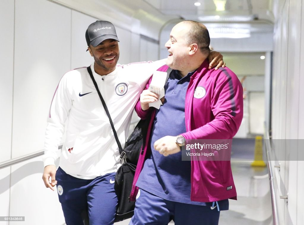 Manchester City's Raheem Sterling boards the flight at Manchester Airport on March 13, 2018 in Manchester, England.