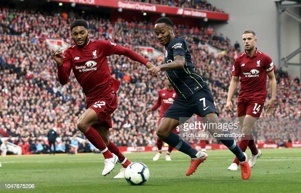 Manchester City's Raheem Sterling drives into the penalty area under pressure from Liverpool's Joe Gomez during the Premier League match between...