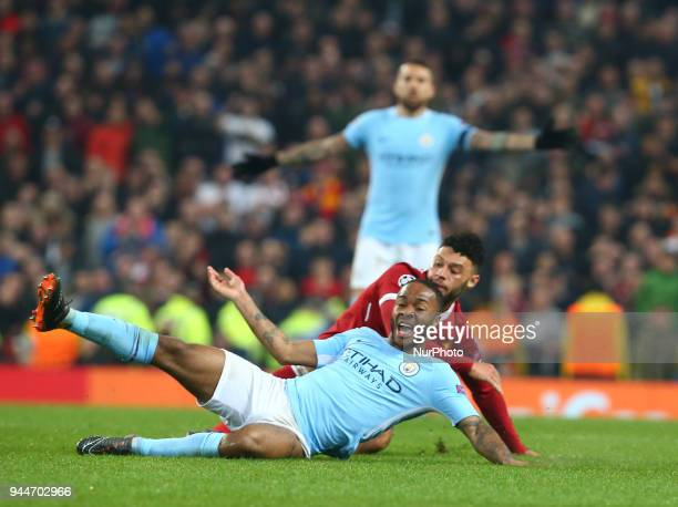 Manchester City's Raheem Sterling gets tackled by Liverpool's Alex OxladeChamberlain during the UEFA Champions League Quarter Final Second Leg match...